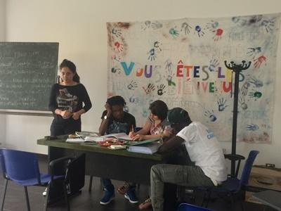 Refugees in a classroom in Italy, where volunteers will help teach English