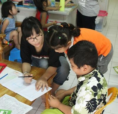 A Projects Abroad volunteer with children at a Care placement in Thailand.